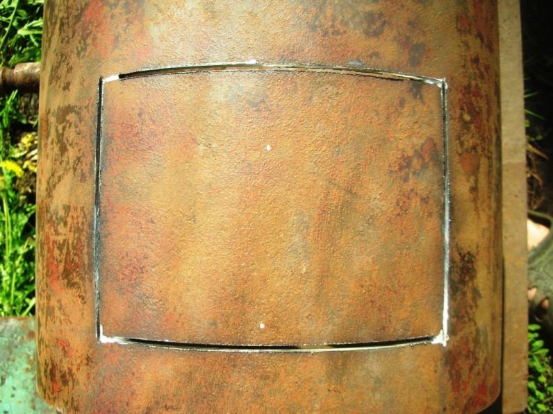 Пример вырезания дверцы для топки