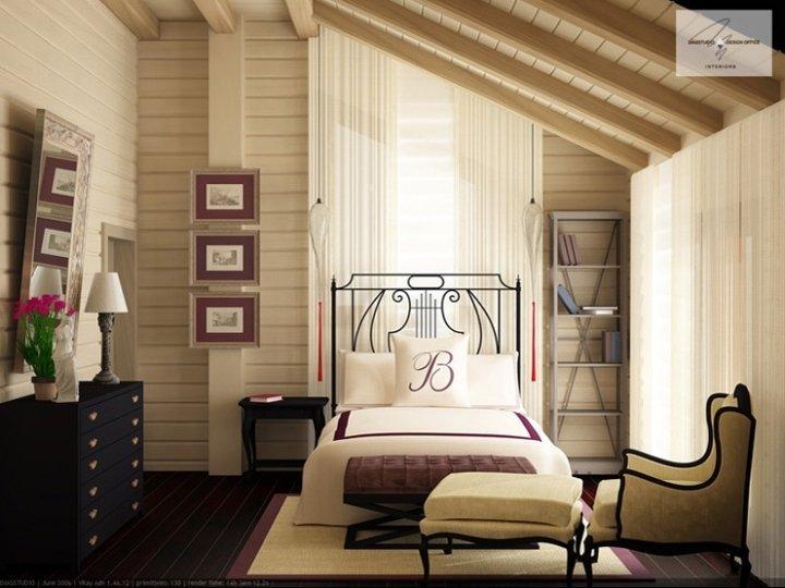 Спальня в мансарде деревянного дома