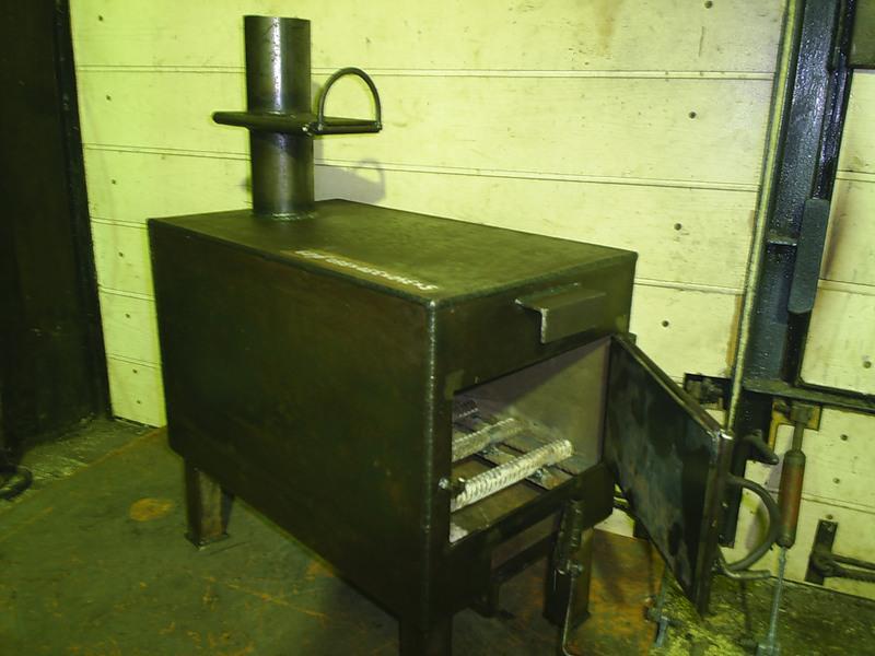 Установка металлической печи-каменки для бани
