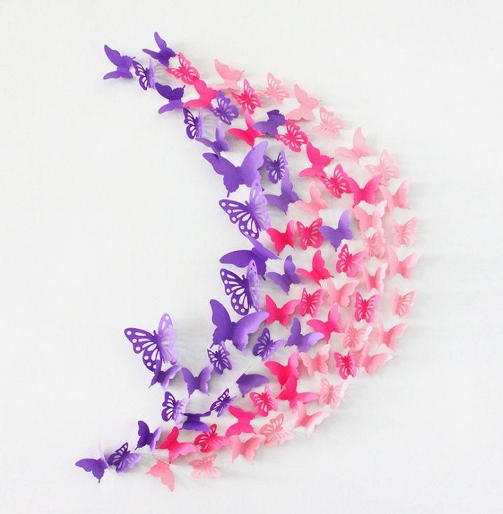 Настенная композиция из цветных бабочек разного размера и формы