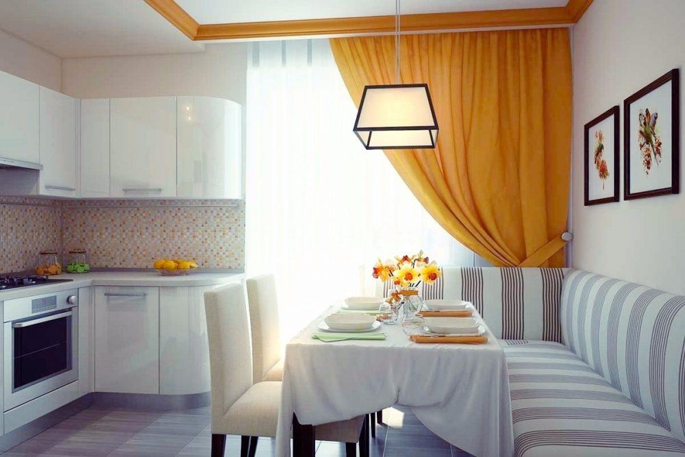 Спокойный и уютный интерьер кухни выполненный в светлых и оранжевых тонах
