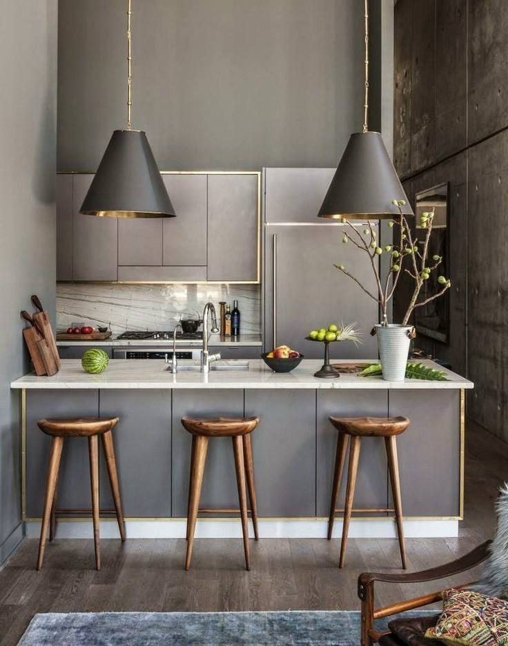 Кухня серого цвета на фоне бетонных стен выглядит естественно и натурально