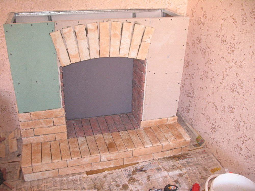 Монтаж плитки на камин